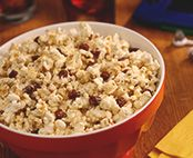 Spaghetti sauce dry mix and Parmesan cheese give popcorn a real Italian pizza flavor.
