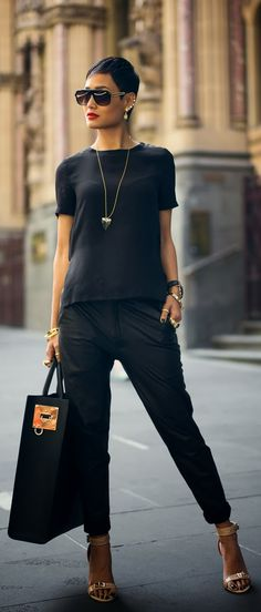 Amazing Outfit With a Mixture of Simple Black Shirt, Black Trousers, Big Handbag and Accesorises