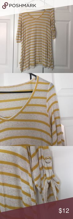 Yellow stripped tunic with half length sleeves Incredibly comfortable and cute half sleeve tunic. This is a great fall tunic with leggings and boots! Tops Tunics