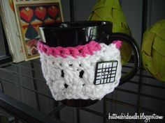 Knitted Cup Cozy with button and pink yarn accent