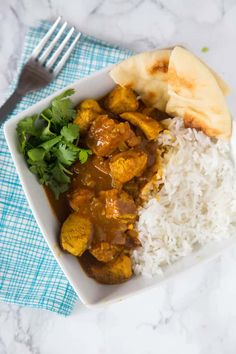 Easy Coconut Chicken Curry just needs thirty minutes, a little rice, and some naan to soak up the fabulous sauce. Amazing.