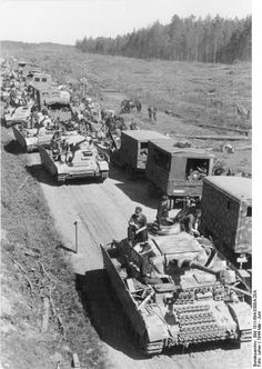 A column of Panzer 4 tanks passing logistic vehicles