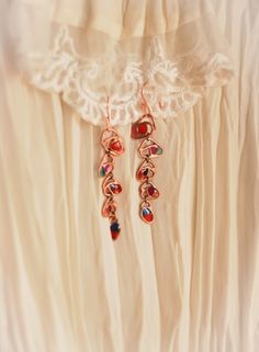 Long and bright copper earrings. Small Roses.