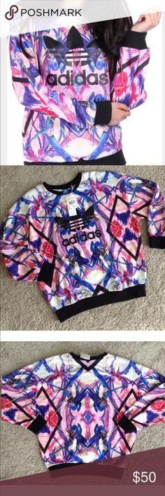 "New Adidas Florera Sweatshirt Bird & Floral Medium NEW with Tags Adidas ""Florera"" Crewneck Sweater/Sweatshirt.   Bright colors, floral/tropical print.   Size MEDIUM in US Women's (UK 14).  100% polyester. MSRP $70. Adidas Tops Sweatshirts & Hoodies"