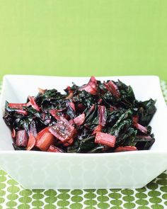 Sauteed Swiss Chard - Martha Stewart Recipes.  Added red pepper flakes to the oil and used rainbow chard... it was perfect!