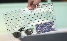 Use clear vinyl and studs to DIY this clutch.