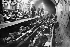 Second home: Shelterers spread across the track in the disused Aldwych tube station in October 1940