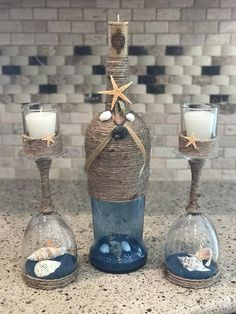 Beautiful beach / coastal wine bottle and wine glass candle holders. Wine bottle has cork candle. Great accent to any room. Measures: Wine bottle = 12 high (14.5 high with cork candle) Wine glasses =10.25 high