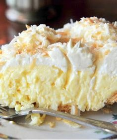 1 cup sweetened flaked coconut  3 cups half-and-half  2 eggs, beaten  3/4 cup white sugar  1/2 cup all-purpose flour  1/4 teasp...