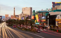 The strip in Las Vegas at dusk Cheap Places To Travel, Cheap Travel, Places To Visit, Las Vegas Trip, Vegas Vacation, Vacation Spots, Vacation Deals, Great Vacations, Travel And Leisure