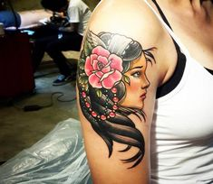 Woman with Rose tattoo by Jackson Tattoo