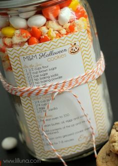 White Chocolate M&M Halloween cookies in a jar. I am totally obsessed with food gifts in a jar right now. Seriously, I love to bake and when everything you need is right there to make homemade goodies ... It's the perfect gift!