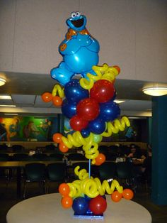 Cookie Monster balloon Topiary Centerpiece ((I like the whirly bits and hope to have something with them someday!))