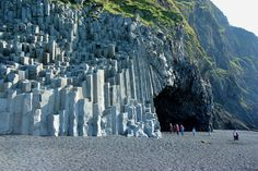 Reynisfjara, Iceland; Reynisdrangar & Basalt Columns. Located at Reynisfjara on the south coast of Iceland are the basalt pillars Reynisdrangar that rise from the sea. Legend has it that these are trolls that turned into stone when day broke.