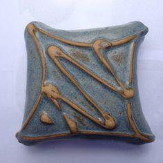 Ceramic cushions. Slip trailing surface decoration. Hardy ceramics