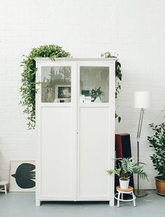 Fun idea... take top panels out of a wardrobe and add glass. Most likely this one came like this but it's something to play with for a fixer upper.