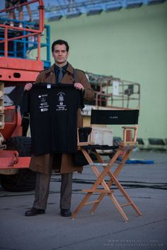 """First look at Henry Cavill as Clark Kent in """"Batman v Superman: Dawn of Justice."""" Technically he's promoting a trust fund for wounded veterans that he represents but IT'S ON SET AND LOOK AT THE COSTUME. He's channeling the Tenth Doctor with that trench coat! @emilybarber96 @Abigailgermo @scarletflower89"""