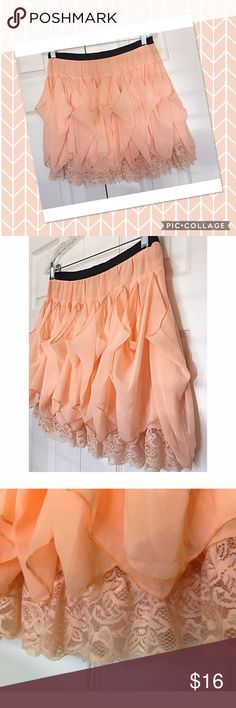 """Blush/light salmon colored short skirt, sz M This skirt looks like a fluffy desert! It features a fixed, flat waist band constructed of black ribbon and also has a hidden zipper! Waist measures 29"""". Excellent condition. Skirts Mini"""