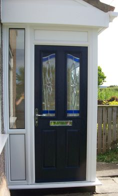 A blue composite door fitted to a porch www.imagewindows.com