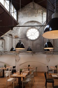 Restaurant Mercat, Amsterdam. Love the ambiance of this restaurant. Looks as though the space was designed in a former church or cathedral building.