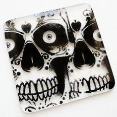 Fused glass skull coasters. Screen printed design