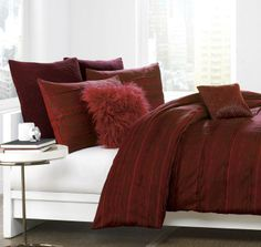 Unwind in style with the Washed Stripe duvet cover by DKNY. Inspired by the deep, luxurious tones of red wine and port, this beautiful bedding features a watercolor pattern of stripes and pinched pleats for an exquisitely refined texture.