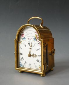 An extremely rare, early Austrian carriage clock - Officer's clock with quarter striking by Ignatz Jahnn, Tyrnau, circa 1775. Brass case and enamel dial painted with delicate summer flowers. A square brass full plate movement, chain-fusee, 3 barrels, 2 hammers, 2 bells, verge escapement, three-arm brass balance. Striking quarters and hour self strike and quarter repeater. Carriage clock in its original leather-covered travelling box. . The open-work back is hinged. An unusual feature ...