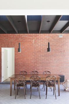 Painted open joist ceiling and exposed brick. House in St Kilda by Clare Cousins Architects.