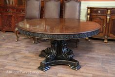 Antique reproduction 60 inch round walnut finished table with black and gold accents.
