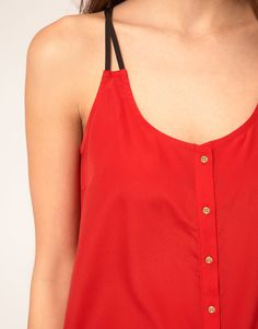 top/dress detail: straps, maybe with a metal ring