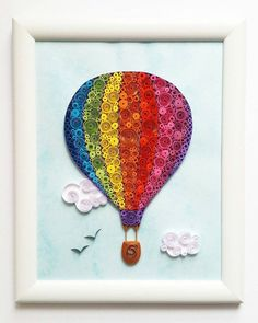 Quilling Art with Hot Air Balloon. The picture is made with 3mm paper strips. Dimensions: 180x230mm Its placed in a white frame without glass. Please let me know through ETSY conversation if you have an questions! Thank You