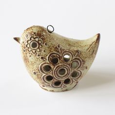 Hanging ceramic bird tea light with hook, stone with rust glaze. Vintage, made in Japan.                                                                                                                                                     More