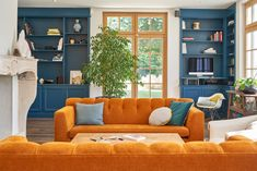 A Stunning French Home Takes Its Gorgeous Color Palette from Nature (Apartment Therapy Main) Sofa Living, Living Room Decor, Apartment Therapy, Studio Apartment, Blue And Orange Living Room, Deco Orange, Orange Sofa, Orange Yellow, Transitional Living Rooms