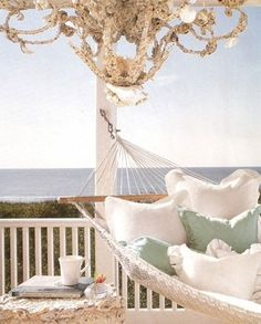 .I wish I lived by the sea and could have this! It looks like the chandelier is even made with seashells!