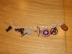 The Avengers Charm Bracelet by GeekyGiraffeGifts on Etsy, $12.95