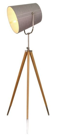 Striking in design, this floor lamp from The Collection will lend a touch of modern style to living spaces. It channels mid-century appeal with a tripod frame in wood with metal accents and a cloth shade that can be adjusted to suit the setting and occasion.