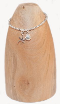 Starfish and shell solid silver bracelet £29.95