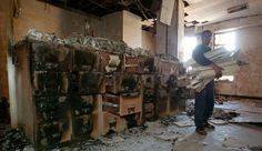Photo: Gleb Garanich/Reuters The looted and burned National Library and Archive in Baghdad in April a week after United States forces seized the capital. via NYTimes: Baghdad Day to Day: Librarian's Journal By PATRICIA COHEN Published: February