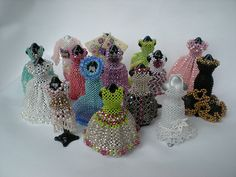 Miniature beaded dresses by Beadwork by Sian, via Flickr