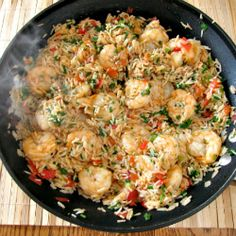 CAJUN SHRIMP AND RICE (Cajun seasoning, tomato, scallion, parsley)