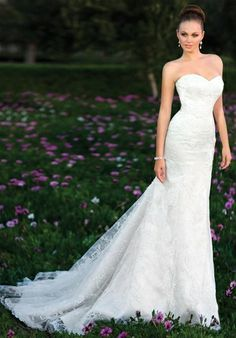 Gown features lace and detachable sash.