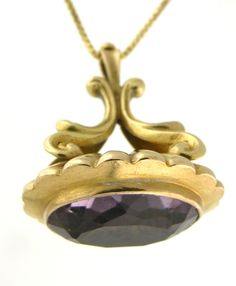Victorian, circa 1860, 18 karat gold, scroll top, watch fob set with a 13.38 carat amethyst.