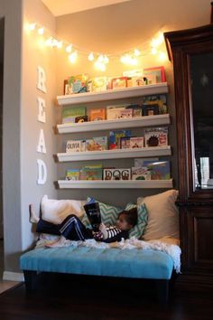 "In order to create a budget-friendly reading nook for her kids in the family room, this clever mom repurposed rain gutters and end caps from Home Depot to make book shelves. Wooden letters from Michael's spell out ""READ."" Smart! See more at Vegas Mother Runner."