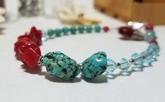 Excited to share the latest addition to my #etsy shop: Red Coral and Turquoise Asymmetrical Beaded Bracelet with Red Coral drop charm #jewelry #bracelet #redcoral #braceletaddict #freeshipping #beaded http://etsy.me/2mkZdhM