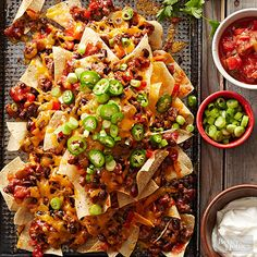 These vegetarian nachos are the perfect addition to any fiesta. Black beans, roasted peppers, salsa and reduced-fat cheese make this the best loaded nachos recipe. Only 200 calories per serving, these healthy nachos are guilt free. Mexican Dishes, Mexican Food Recipes, Ethnic Recipes, Nacho Recipes, Tostada Recipes, Vegetarian Mexican, Mexican Meals, Mexican Cooking, Meat Recipes