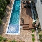 13 best swimming pool design ideas and construction in home:long rectangular swimming pool small design beside terrace house