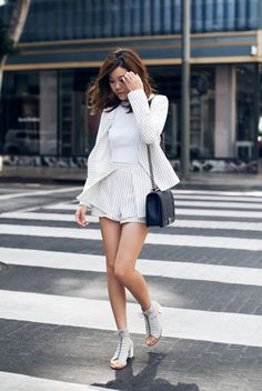 spring / summer - street style - street chic style - summer outfits - casual outfits - party outfits - white tee + black and white striped blazer + black and white striped skorts + black and white striped co-ord + black and white striped set + grey lace up sandals + black shoulder bag