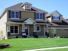 LDK Home Exterior with James Hardie siding featuring color plus painting in Tuscan Gold.