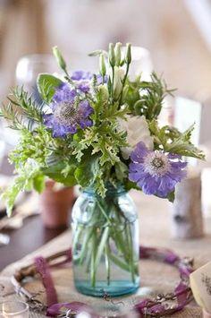 Garden flowers in blue mason jar