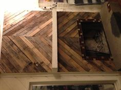 I covered my fireplace in pallet wood!!!